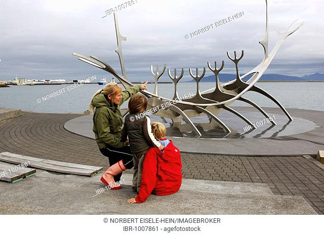 Woman and two children observing Solfarer, Viking ship made from stainless steel, Reykjavik, Iceland, Europe