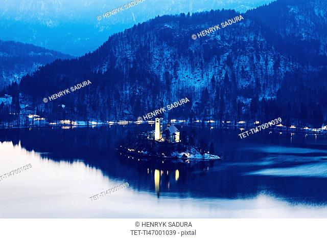 Lake Bled and illuminated Church of the Assumption on island