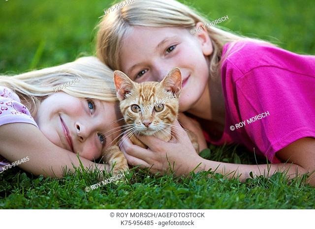 sisters with kitten