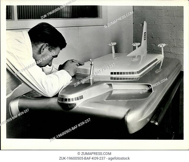 May 05, 1960 - Air - Cushioned travel for 300 passengers: A London (England) model maker works away at a small edition of a projected hovercraft for skimming...