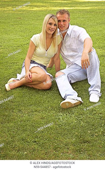 Young couple sitting together in a park