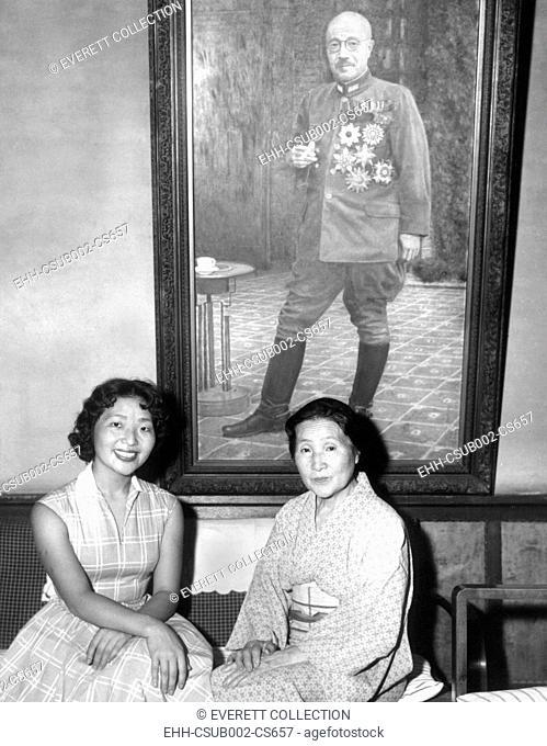 Kimiye Tojo, 26, with her mother, Katseko, before a painting of Japanese Premier Hideki Tojo. Tojo's daughter, Kimiye was offered a scholarship by the Portia...
