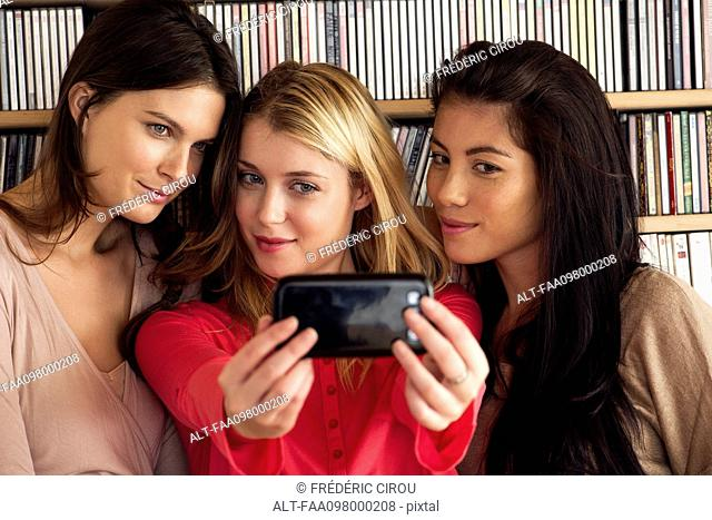 Young women posing together for selfie