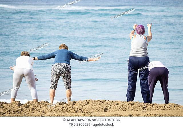 A group of elderly local women at their daily exercise class on Las Canteras beach in Las Palmas, Gran Canaria, Canary Islands, Spain