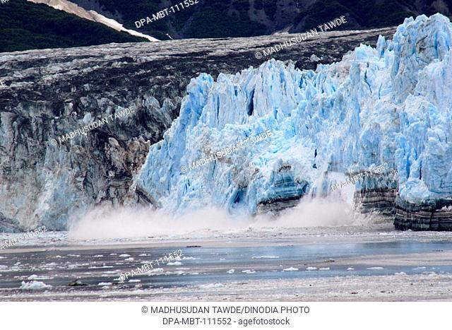 Calving ice falling off of Hubbard glacier ; the longest tidewater glacier in Alaska; Saint Elias  national park ; disenchantment bay ; Alaska ; U.S.A