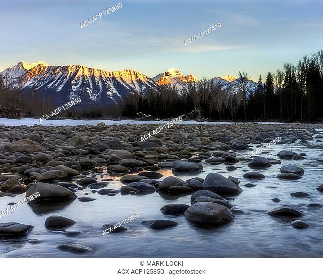 a winter sunrise on the Elk River looking towards Mount Fernie and the Three Sisters, Fernie, BC, Canada