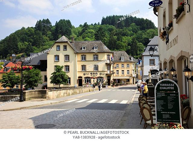Vianden, Grand Duchy of Luxembourg, Europe  Street scene and pavement cafe by the bridge in the Our Valley