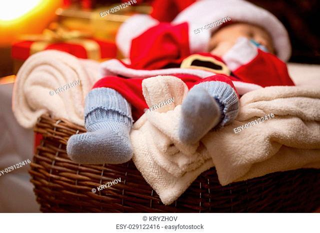 Closeup photo of little baby Santa feet in blue wool socks