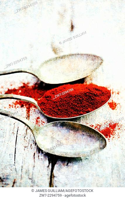 Paprika with antique spoons textured image