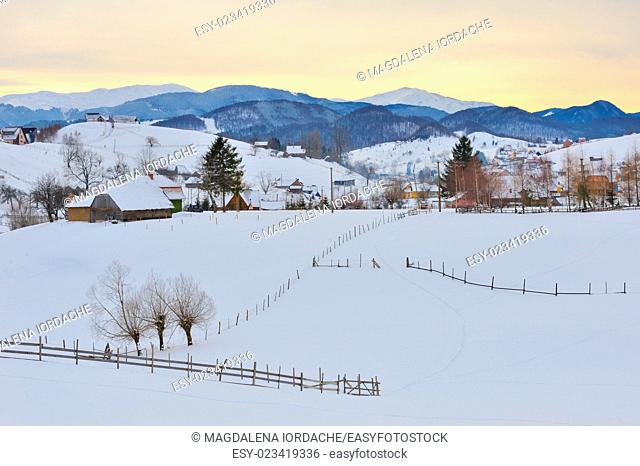 Winter romanian village and mountain landscape
