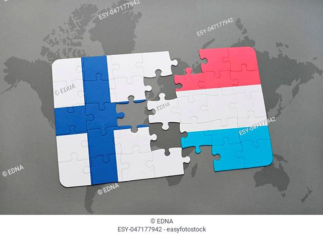 puzzle with the national flag of finland and luxembourg on a world map background. 3D illustration