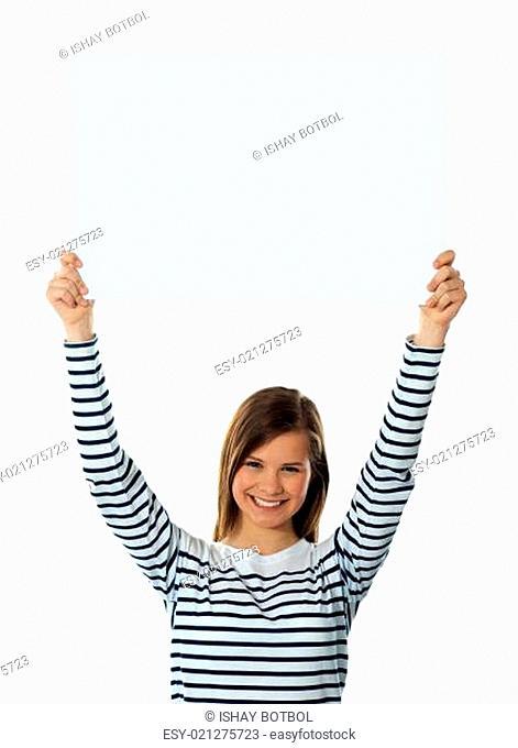 Cute girl lifting blank placard