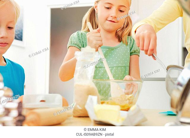 Children baking, mixing ingredients