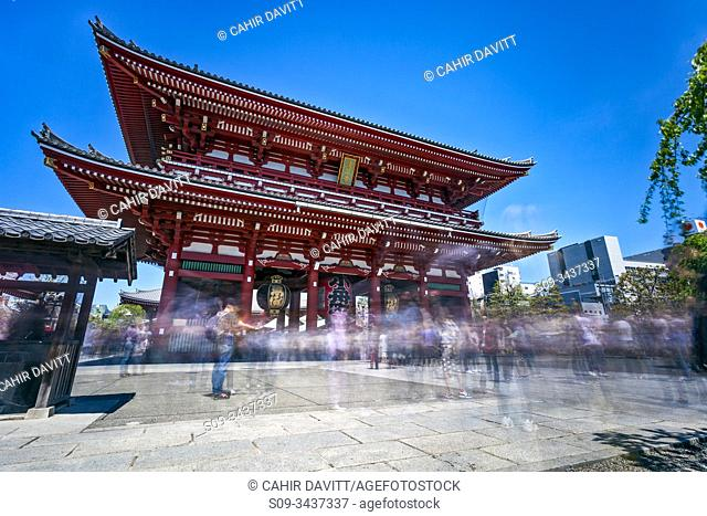 Tourists move through the Hozomon Gate of the Sensoji Complex, Hanakawado, Tokyo To, Japan