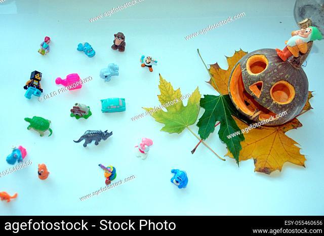 KIEV, UKRAINE - OCTOBER 27, 2020: Various little kids toys lined up for halloween the celebration