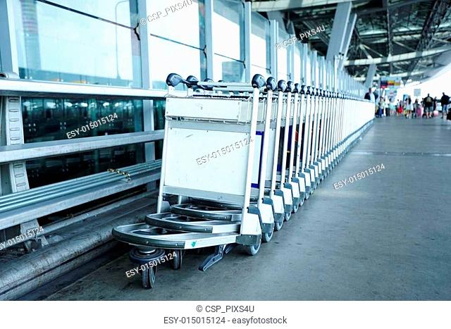 Trolleys luggage in a raw in airport