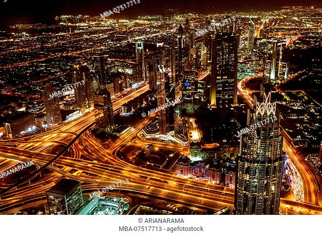 Aerial view of downtown Dubai and skyscrapers at night from the top of Burj Khalifa
