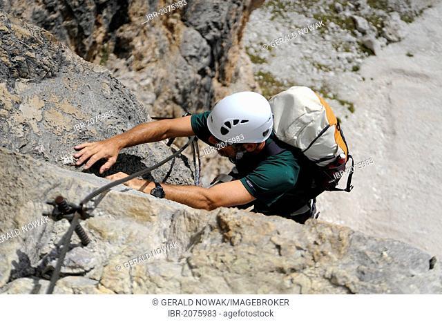 Mountaineer climbing a sheer rock wall, Piz Boe, Dolomites, South Tyrol, Italy, Europe