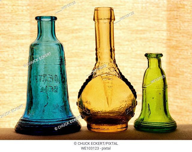 Three small antique bottles