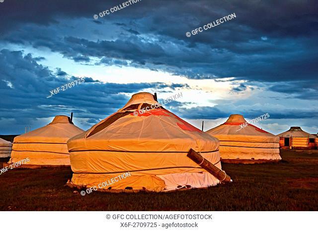 Gers or yurts of the Khatan Ugii Tourist Camp at sunset at Lake Ogii Nuur, Mongolia