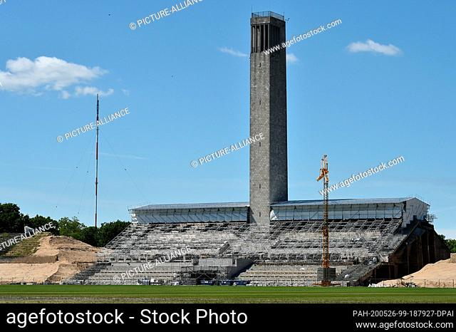 20 May 2020, Berlin: Renovation work on the grandstand at the bell tower of the Olympiastadion in Berlin. Photo: Sven Braun/dpa-Zentralbild/ZB