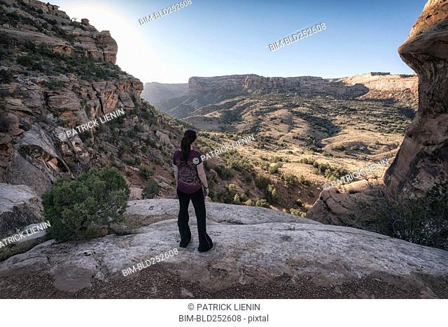 Woman admiring scenic view of desert