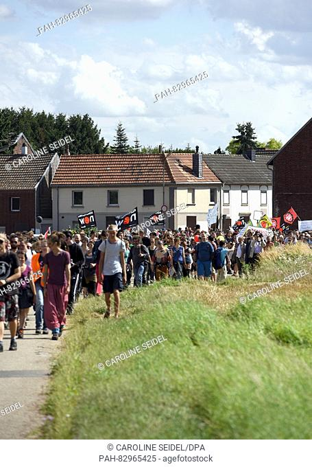 Protesters walking through the deserted village Borschemich during the demonstration 'Stopp RWE' in Erkelenz, Germany, 20 august 2016