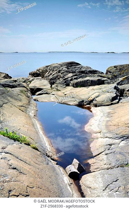 Granitic rocks smoothed by winter ice on the finnish coast