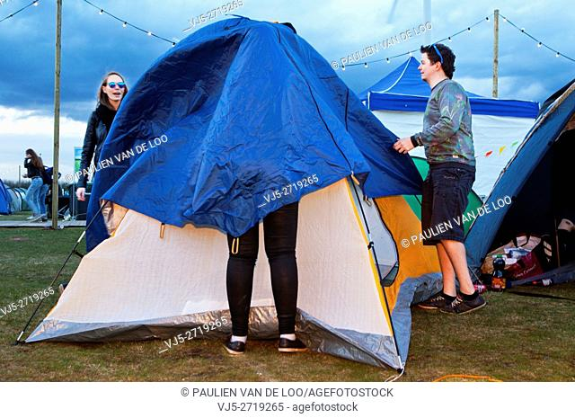 Lommel, Belgium, girls and boys planning the night and pitching their tent, place to sleep