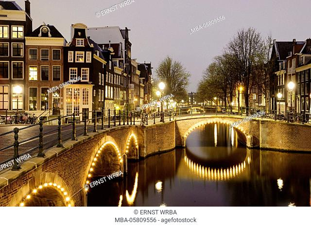 illuminateded bridge, dusk, 'Keizersgracht' (canal), Amsterdam, Holland, Netherlands