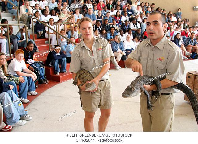 Naturalists with alligators during Serpentarium show, DFYIT (Drug Free Youth In Town) Drug Free Fest at Jungle Parrot, Miami. Florida, USA