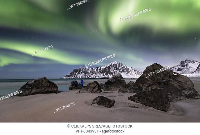 Skagsanden beach with northern light, Flakstad village, Svolvear district, Lofoten Islands, Norway