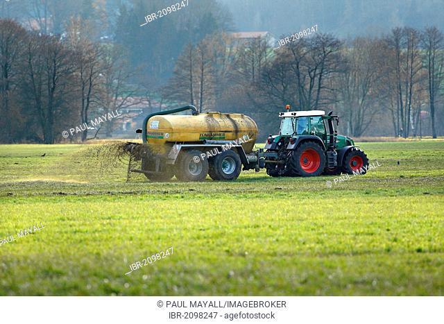 Liquid cow manure being sprayed on field, Chiemgau, Upper Bavaria, Germany, Europe