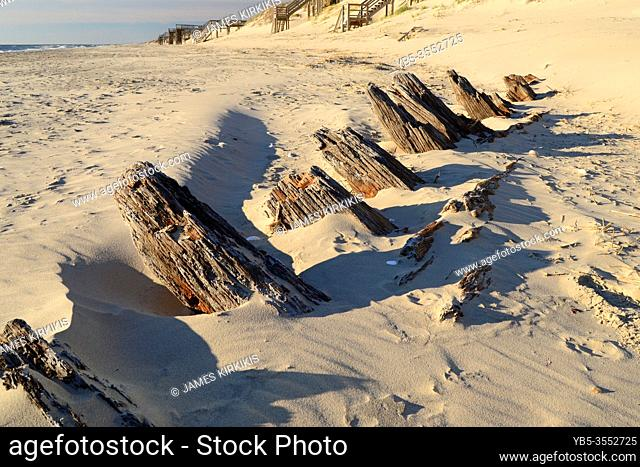 The remains of an 18th Century shipwreck poke through the sands along the Outer Banks of North Carolina