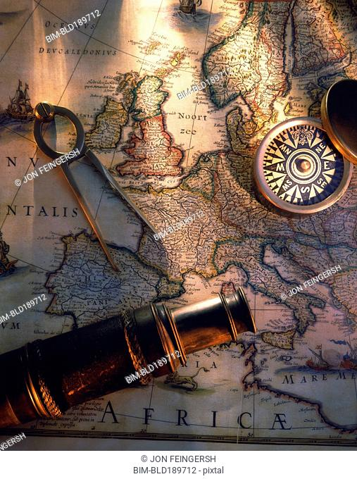 Map of globe with nautical navigation devices