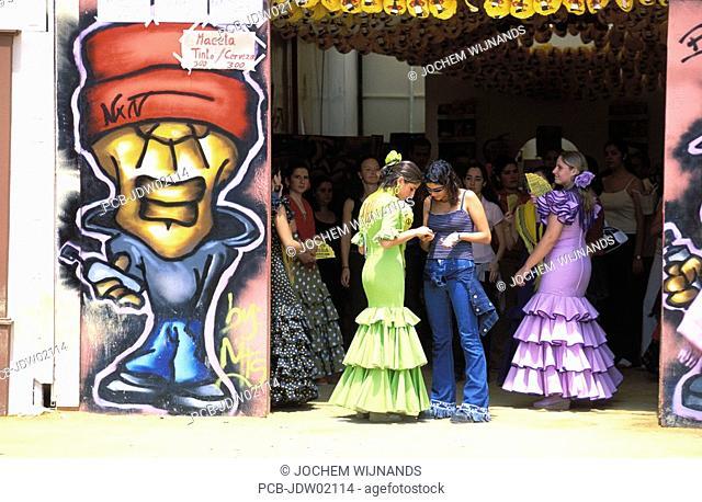 Jerez de la Frontera, girls in flamenco dress in a caseta for the youth at the Feria del caballo