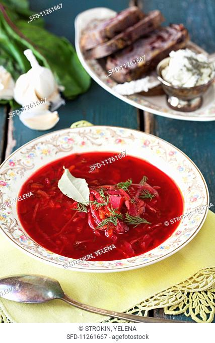 Vegetarian borscht with bread and cheese spread