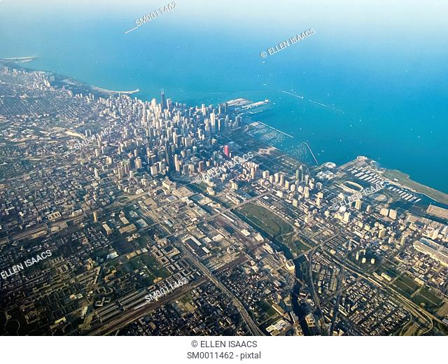 Aerial view of downtown Chicago along Lake Michigan with surrounding metropolitan area