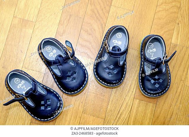 Two paris of shoes for one year old twin brothers
