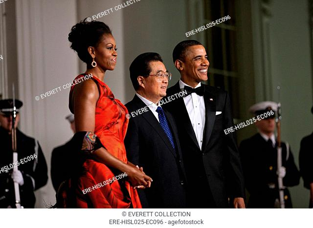 President and Michelle Obama welcome President Hu Jintao of China to the White House for the State Dinner Jan. 19 2011. Michelle wears a Chinese red evening...