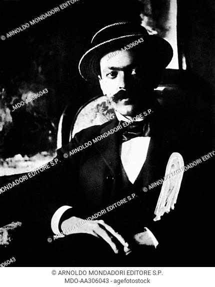 Italo Svevo with proofs. Italo Svevo, Italian writer and dramatist, sitting with proofs under his arm. 1893