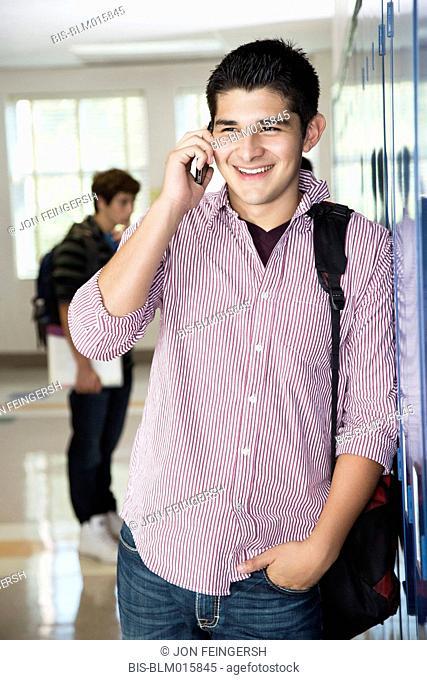 Hispanic high school student talking on cell phone