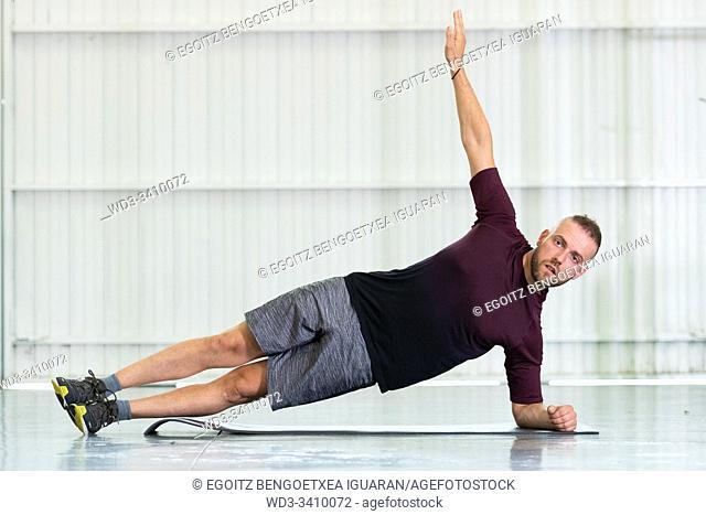 Young man making core workout