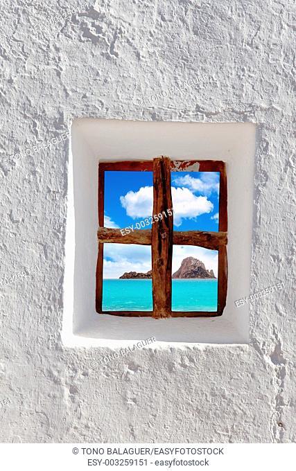 Ibiza Es vedra island view through whitewashed house window