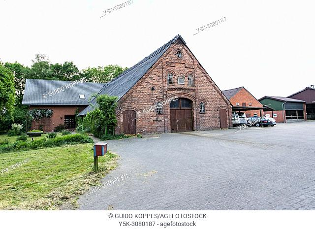 Niedersachsen, Germany. Exterior of a farmhouse stable and residence on a quiet and rural farmer's yard