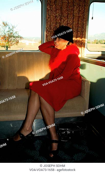 1940's reenactor sits on Pearl Harbor Day Troop train reenactment from Los Angeles Union Station to San Diego
