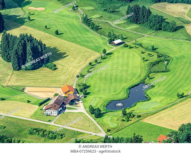 Lonely farm house surrounded by meadows, lake with fountain, small golf course, aerial view, slope of bavarian alps near Oberstdorf, Allgäu, Allgaeu, Bavaria