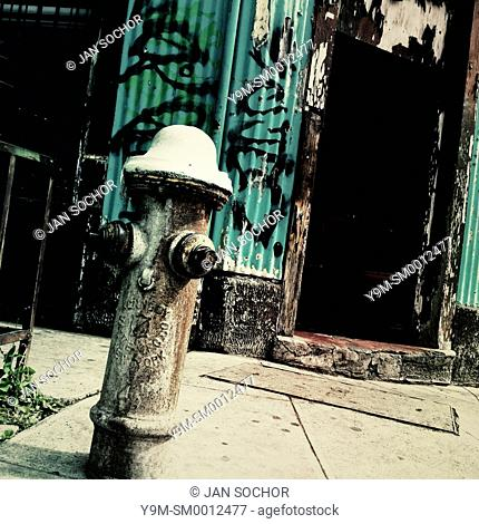 A water hydrant seen in front of a house made of wood and sheet metal on the street of San Salvador, El Salvador, 21 December 2013