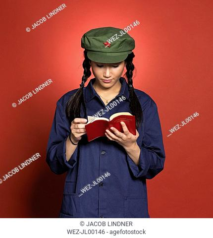 Young chinese woman, reading red book