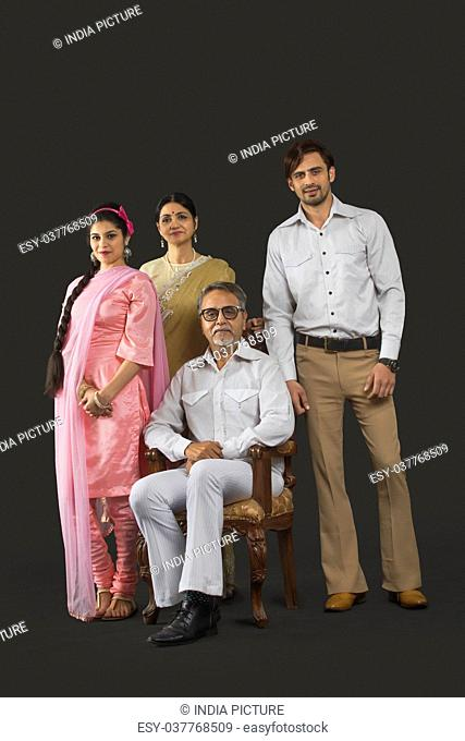 Portrait of Indian two generation family in retro 70s clothing